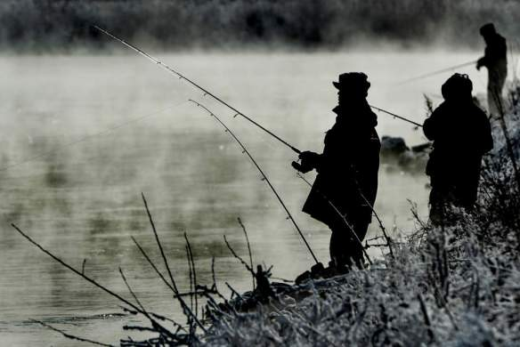 RON JOHNSON/JOURNAL STAR   Fishermen cast their lines as steam rises from Powerton Lake, north of Pekin, on a cold Dec. 29 with temperatures dipping into the single digits.