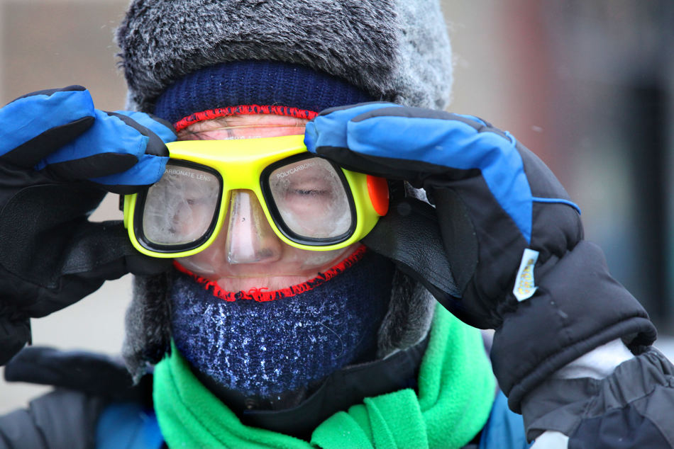 Wesley Hoague protects himself from the cold with a pair of goggles as he heads to class at Milwaukee Institute of Art and Design (MIAD)  in Milwaukee on Thursday, Jan. 23, 2014. A wind chill advisory from the National Weather Service is in effect until noon on Thursday. (AP Photo/Milwaukee Journal-Sentinel, Mike De Sisti)