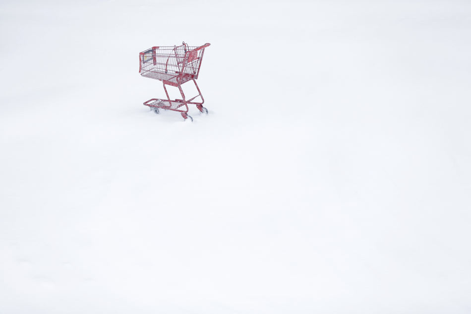 A shopping cart sits idle in a Trader Joe's parking lot during a winter snowstorm Tuesday, Jan. 21, 2014, in Philadelphia. A storm is sweeping across the Mid-Atlantic and New England. The National Weather Service said the storm could bring 8 to 12 inches of snow to Philadelphia and New York City, and more than a foot in Boston. (AP Photo/Matt Rourke)