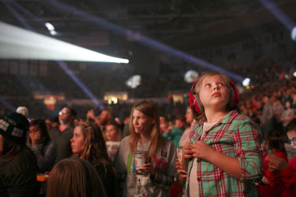 KRISTEN ZEIS/JOURNAL STAR Maci McCants, 7, watches the big screen during Thousand Foot Krutch's performance at the Winter Jam 2014 Tour on January 26 at Carver Arena. McCants and her family drove from Galesburg to attend the Christian music concert.
