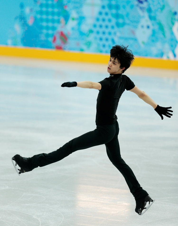 Yuzuru Hanyu of Japan performs during a figure skating practice session at the training rink ahead of the 2014 Winter Olympics, Tuesday, Feb. 4, 2014, in Sochi, Russia. (AP Photo/Ivan Sekretarev)