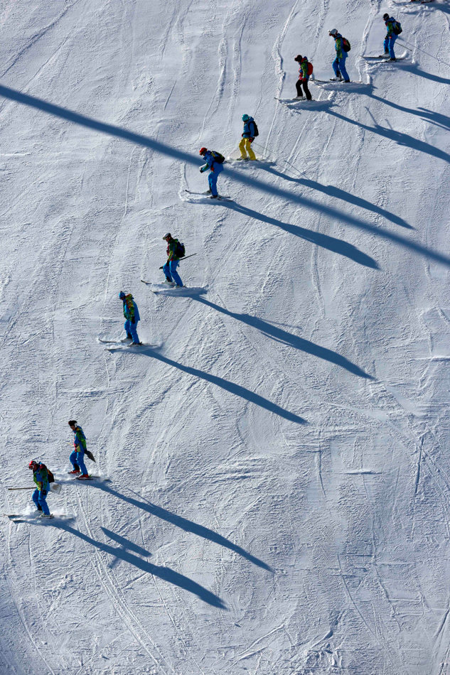 Olympic volunteers ski down the slalom course the 2014 Winter Olympics, Monday, Feb. 3, 2014, in Krasnaya Polyana, Russia. (AP Photo/Gero Breloer)