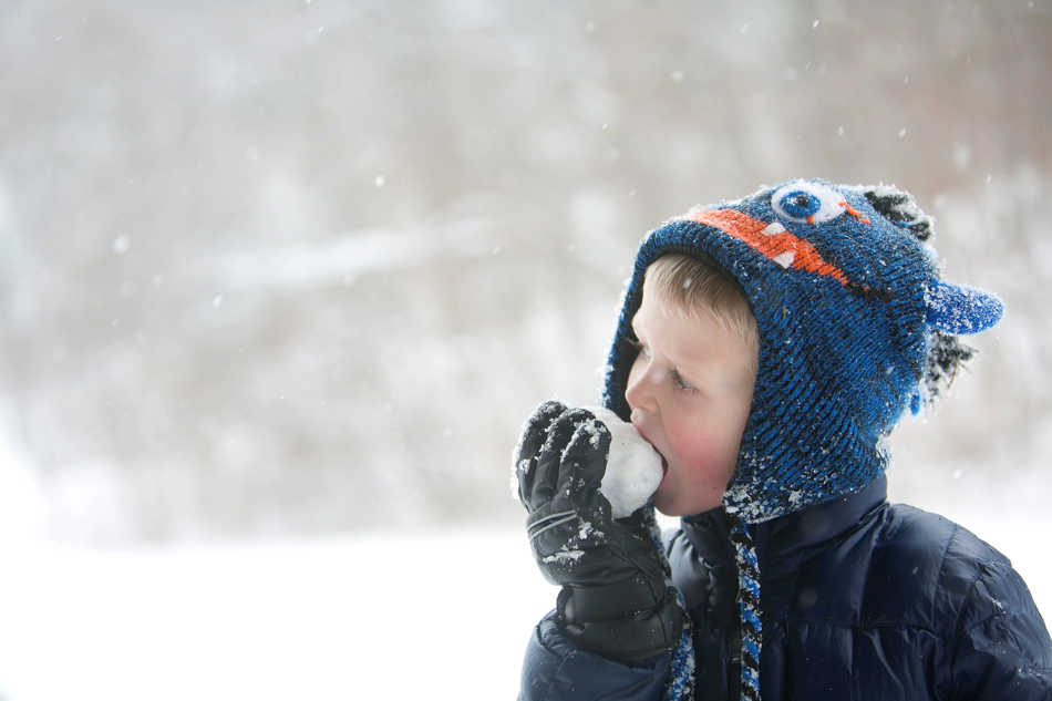 KRISTEN ZEIS/JOURNAL STAR Jack Mathison, 5, takes a break from sledding to eat a ball of snow  on Saturday, Feb 1 at Detweiller Park. Mathison was joined at the park by his dad and brothers.