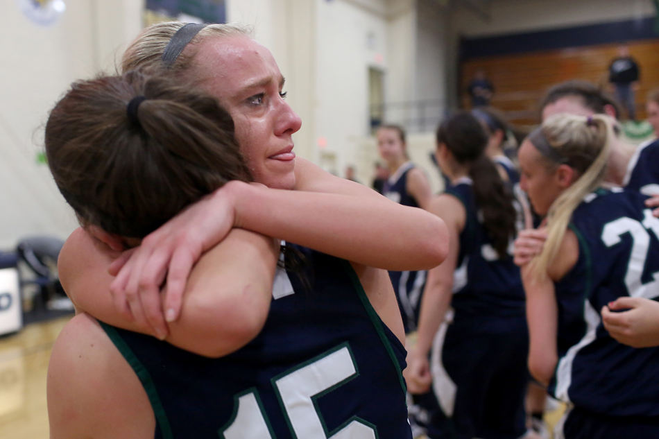 KRISTEN ZEIS/JOURNAL STAR Peoria Notre Dame's Bridget Bill (20) embraces fellow teammate Maggie Maloof after their win against Richwoods on Friday.