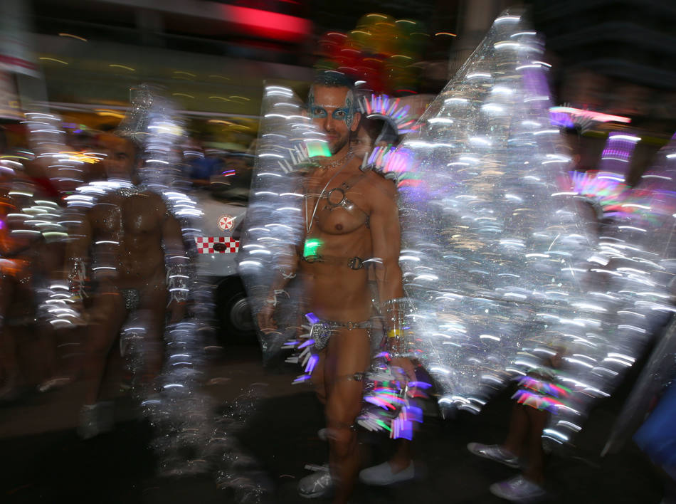 Participants in the annual gay and lesbian Mardi Gras parade prepare for the event in Sydney, Saturday, March 1, 2014. Ten Thousand marchers along with 144 floats are entered in the 36th parade. (AP Photo/Rick Rycroft)