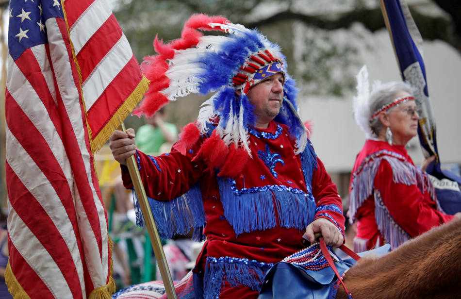 Members of the Cajun Indians and Cowboys Riding Club march through the streets during the Tucks Mardi Gras parade in New Orleans,  Saturday, March 1, 2014. (AP Photo/Bill Haber)
