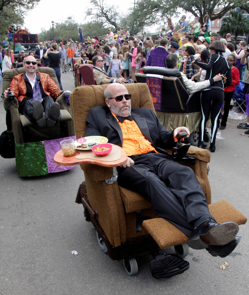 A group of people ride their motorized recliners in the Tucks Mardi Gras parade in New Orleans, Saturday, March 1, 2014. This is the last full weekend of the Mardi Gras season which will end on Tuesday. (AP Photo/Bill Haber)