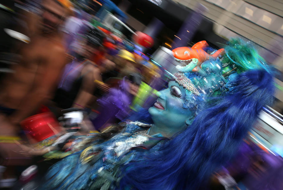 A Participant in the annual gay and lesbian Mardi Gras parade prepares for the event in Sydney, Saturday, March 1, 2014. Ten Thousand marchers along with 144 floats are entered in the 36th parade this year. (AP Photo/Rick Rycroft)