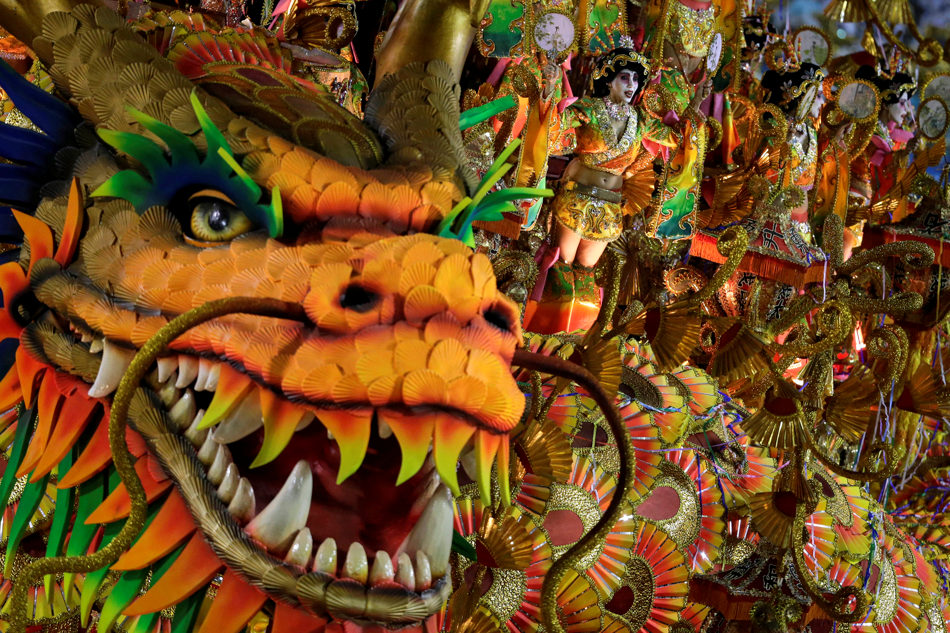 Performers from the Beija Flor samba school parade on a float during carnival celebrations at the Sambadrome in Rio de Janeiro, Brazil, Monday, March 3, 2014. (AP Photo/Felipe Dana)