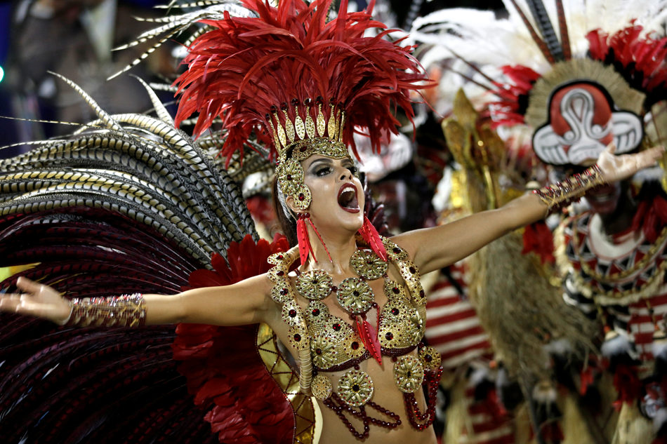 A performer from the Academicos do Grande Rio samba school parades through the Sambadrome during carnival in Rio de Janeiro, Brazil, Sunday, March 2, 2014. (AP Photo/Silvia Izquierdo)