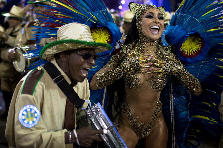 Drum Queen Sabrina Sato from the Vila Isabel samba school parades during carnival celebrations at the Sambadrome in Rio de Janeiro, Brazil, Tuesday, March 4, 2014. Brazil's Carnival is maintaining its frenetic pace, with hundreds of roving parties taking over Rio de Janeiro's streets and famed samba school parades heading into their final night. (AP Photo/Felipe Dana)