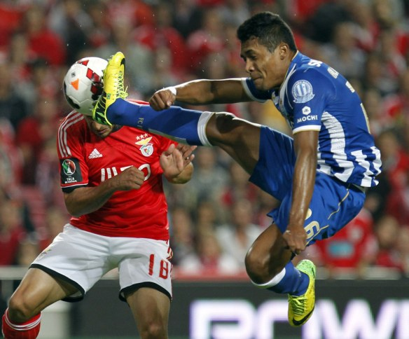 Benfica's Eduardo Salvio, left, from Argentina, heads the ball to score the opening goal past Porto's Alex Sandro, from Brazil, during a Portugal Cup semifinal second leg soccer match between Benfica and Porto at Benfica's Luz stadium in Lisbon, Wednesday, April 16, 2014. (AP Photo/Francisco Seco)