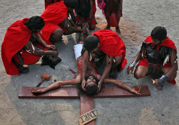An Indian Christian devotee enacts the crucifixion of Jesus Christ to mark Good Friday at The Mount Carmel Church in Hyderabad, India, Friday, April 18, 2014. Christians all over the world are marking Good Friday, the day when Christ was crucified. (AP Photo/Mahesh Kumar A.)