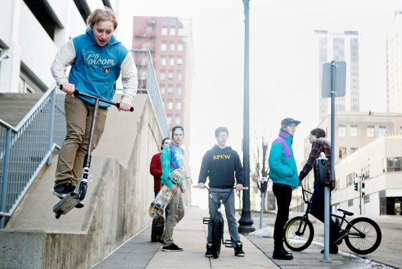 KRISTEN ZEIS/JOURNAL STAR Warmer weather and extra hour of daylight gives Cyle Young of East Peoria a chance to perform tricks on his scooter while hanging out with his friends on Sunday, March 9 in Downtown Peoria. The group said that they frequent the downtown area with their bikes, skateboards and scooters because they don't feel that Peoria has any decent options for skate parks.