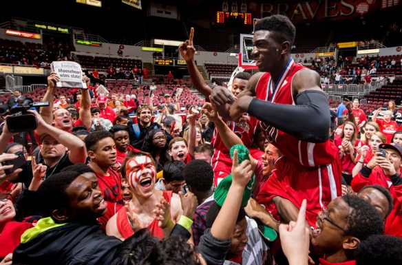 FRED ZWICKY/JOURNAL STAR Mooseheart guard Hameed Odunewu celebrates with fans as the Red Ramblers win the Class 1A championship 63-47 over Heyworth on Saturday, March 15 at the Peoria Civic Center.