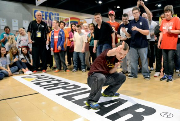 DAVID ZALAZNIK/JOURNAL STAR Dunlap Middle School eighth-grader Oliver Smith, 14, finishes with a flourish in a dance-off Tuesday, March 18 during Access the March Madness Experience at the Peoria Civic Center. Students from around the state with disabilities, group home residents and members of Special Recreation Associations were invited to the March Madness Experience with its games adapted for more accessible play.