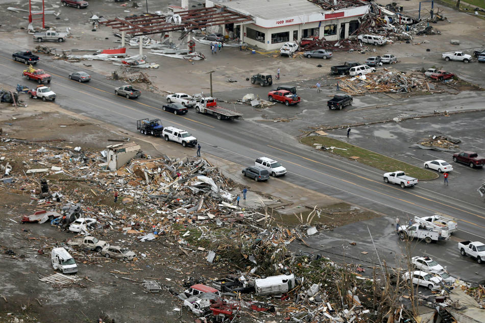 Homes and businesses are wrecked in downton Vilonia, Ark., Monday, April 28, 2014 after a tornado struck the town late Sunday. The most powerful twister this year carved an 80-mile path of destruction through suburbs north of the state capital of Little Rock, killing at least 16 people. (AP Photo/Danny Johnston)
