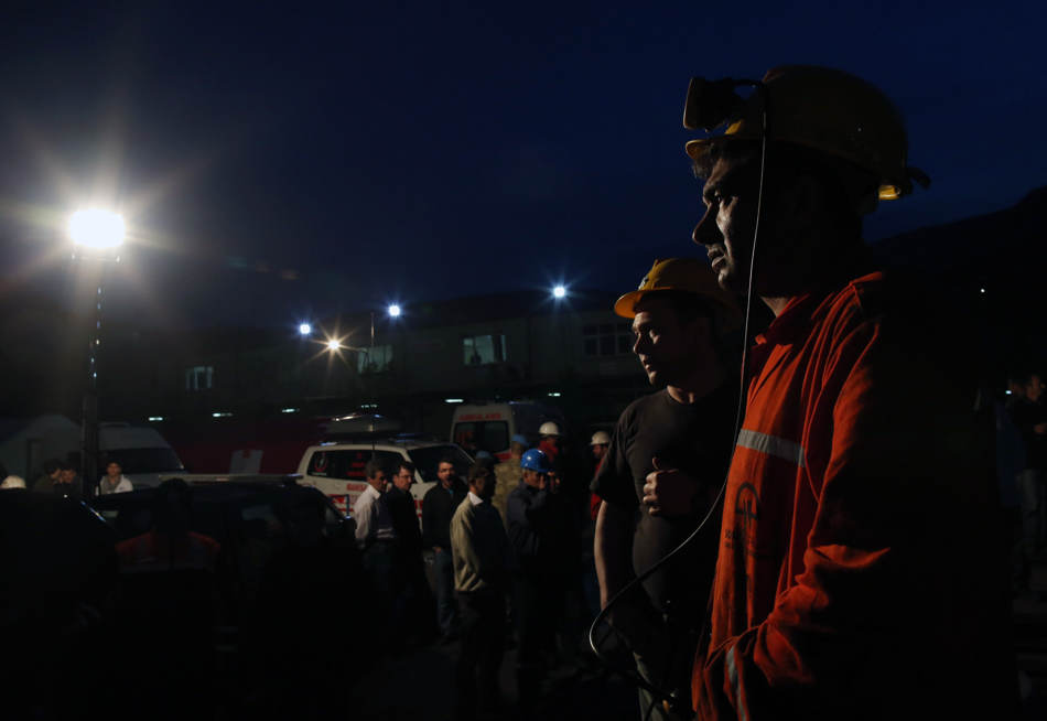 Miners wait outside the mine in Soma, western Turkey, early Wednesday, May 14, 2014. Rescuers desperately raced against time to reach more than 200 miners trapped underground Wednesday after an explosion and fire at a coal mine in western Turkey killed at least 205 workers, authorities said, in one of the worst mining disasters in Turkish history. Turkey's Energy Minister Taner Yildiz said 787 people were inside the coal mine in Soma, some 250 kilometers (155 miles) south of Istanbul, at the time of the accident and 363 of them had been rescued so far. (AP Photo/Emrah Gurel)