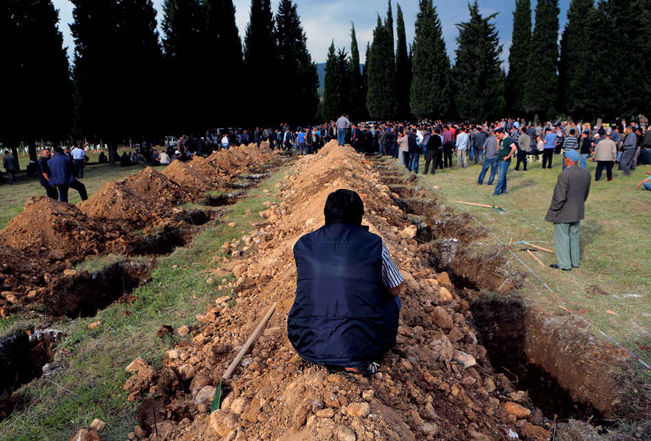 "Rows of open graves for the mine accident victims are seen in Soma, Turkey, Wednesday, May 14, 2014. A violent protest erupted Wednesday in the Turkish city of Soma, where at least 238 coal miners have died after a mine explosion. Many in the crowd expressed anger at Prime Minister Recep Tayyip Erdogan's government. Rocks were being thrown and some people were shouting that Erdogan was a ""Murderer!"" and a ""Thief!""(AP Photo/Depo Photos)"