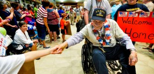 A Heroes Welcome as War Veterans Return From Honor Flight