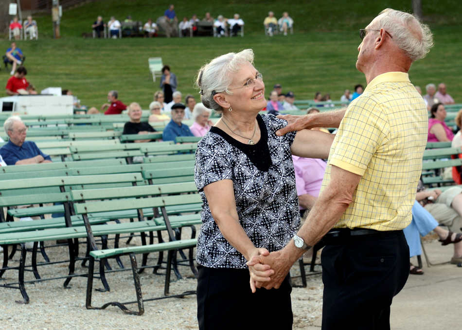 DAVID ZALAZNIK/JOURNAL STAR  Shirley Hackmann and her husband, Larry, of Washington, dance to the music of the Peoria Municipal Band as it opens its 77th season with a free concert Sunday, June 1 at Glen Oak Amphitheater in Peoria. David Vroman conducted the concert with Libby Snyder appearing as the featured vocal soloist.
