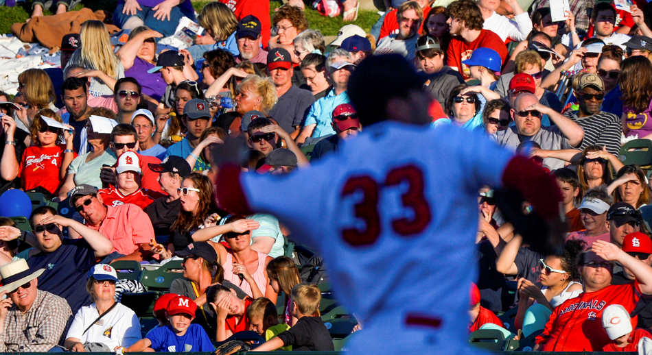 RON JOHNSON/JOURNAL STAR  The crowd basks in sunlight as Chiefs pitcher Rob Kaminsky delivers on the mound Saturdy, June 14 at Dozer Park in Peoria.