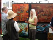 Artist Pegi Smith discusses her work and the charity her sales that day would benefit with visitors