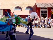 Then, for a little performing arts practice to complement their artistic creation of the dragon heads, Tami's students transform into dragons for the parade.