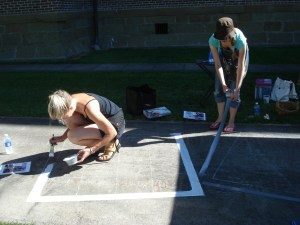 Chalk artists setting up their grids early this morning.