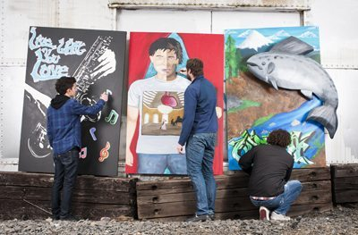 LIFE Art student Adrian Chavez, mentor Aaron Dykstra and student Luis Rodriguez. Photo by Ezra Marcos.