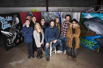 Front (l-r): LIFEArt student Adrian Chavez, student Karla Lopez, mentor Aaron Dykstra, student Mello Saldivar-Anaya who painted the murals in the background of our February 2015 cover photo. Back (l-r): LIFEArt founder Phil Ortega, mentor Caroline Wasick, mentor Nicole Paradis, student Luis Rodriguez. Photo by Ezra Marcos.