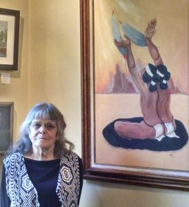 "Sarah Jo Cummins with her painting ""Grandmother's Gift of Life"""