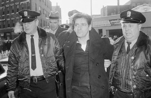 Albert DeSalvo, 35, is surrounded by police after his capture in Lynn, Ma. on Feb. 25, 1967. DeSalvo was nabbed in a store a day after he escaped from Bridgewater State Hospital for the criminally insane.  (AP Photo)