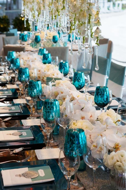 all white floral with turquoise and silver accented tablescape