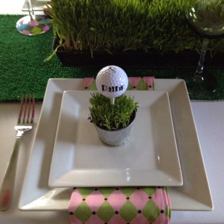 Golf ball place card at golf party