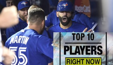 Toronto Blue Jays Jose Bautista celebrates his three-run homer with teammate Russell Martin during seventh inning game 5 American League Division Series baseball action in Toronto on Wednesday, Oct. 14, 2015. (Nathan Denette/CP)