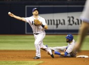 Toronto Blue Jays' Jose Bautista (19) interferes with Tampa Bay Rays second baseman Logan Forsythe as he looks to turn a double play on a ball hit by Edwin Encarnacion, that ended the baseball game after review, in St. Petersburg, Fla., on Tuesday, April 5, 2016. The Rays won 3-2. (Will Vragovic/The Tampa Bay Times via AP) ORG XMIT: FLPET321