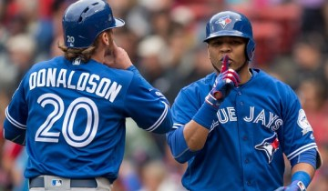 BOSTON, MA - JUNE 5: Edwin Encarnacion #10  of the Toronto Blue Jays reacts with Josh Donaldson #20 after hitting a two-run home run against the Boston Red Sox in the third inning on June 5, 2016  at Fenway Park in Boston, Massachusetts. (Photo by Michael Ivins/Boston Red Sox/Getty Images)