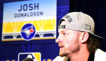 SAN DIEGO, CA - JULY 11:  Josh Donaldson #20 of the Toronto Blue Jays speaks to the press during Media Availability for the 87th Annual MLB All-Star game at the Manchester Grand Hyatt on July 11, 2016 in San Diego, California.  (Photo by Harry How/Getty Images)