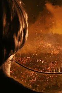 Chandler Canterbury as Caleb Koestler watches a firestorm approach his window.