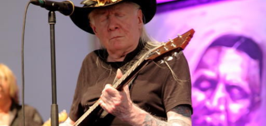 photo by John Davisson  In this May 3, 2014, photo, Johnny Winter performs at the 2014 New Orleans Jazz & Heritage Festival at Fair Grounds Race Course in New Orleans.