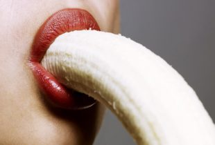 Woman-with-banana-in-mouth-468451