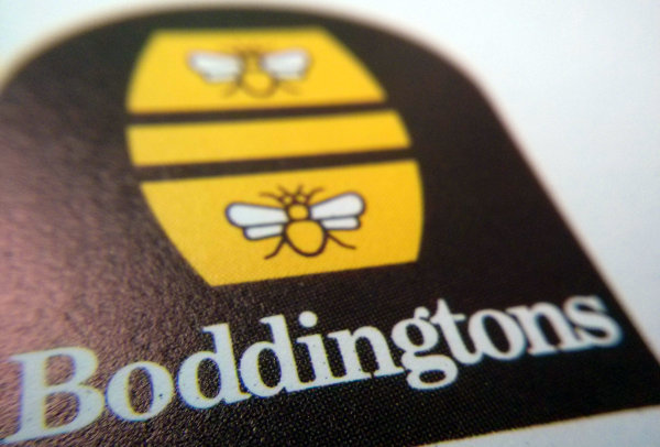 Macro shot of Boddington's logo on old paper.