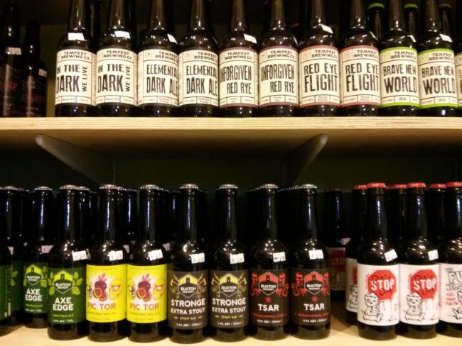 Beer bottles on shelves.
