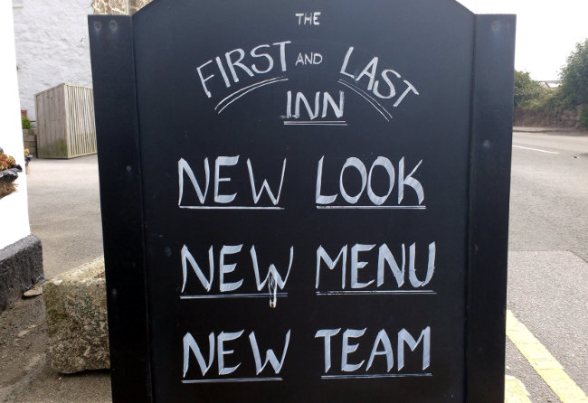 Sign outside the First & Last: New Look, New Menu, New Team.