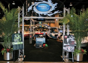 Russell Marine's goal is to have the best display at each boat show, with a grand  entrance, plush carpets, fresh greenery and more.