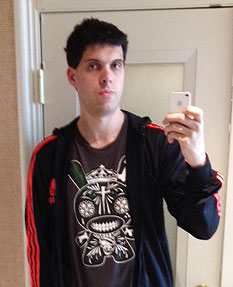 A road warrior self-portrait taken in a hotel mirror