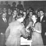 """Presentation of Maadi Cup to E.V. Dawson by  Wife of President of the Cairo River Club. Brig Burrows on Right."""