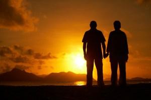 couple worshipping sun