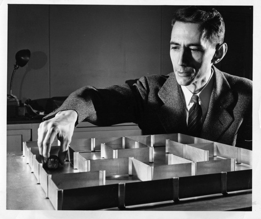 Claude Shannon working on a maze